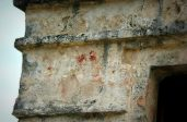 Mayan hand prints in red paint on a Tulum ruin in Quintana Roo, MX. The red hands are associated directly with the Descending God. The color red was the color the Mayas gave to the East. (Photo/Kendra Yost)